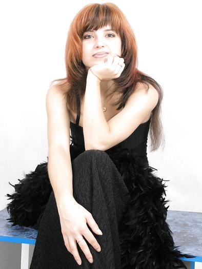 Redhead hottie in black dress