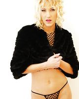 Nasty blonde Justine plays with big dildos