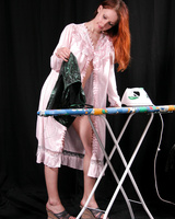 Sexy ginger babe irons her clothes