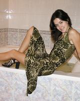 Slender brunette in the bath