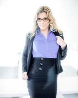 Mature lady Cory Chase takes off her tight skirt for nude solo poses