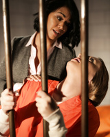 Dana Vespoli and Harley Jane have a lesbian session in a prison cell