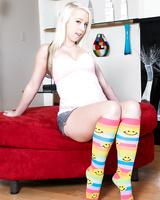 Platinum blonde teen Darcie Belle strips down to multi-colored knee socks