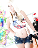 Platinum blonde teen Darcie Belle undressing and covering herself in oil