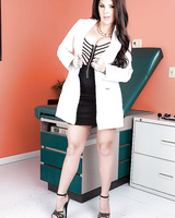 Brunette doctor Darling Danika is demonstrating her sexy tattoos