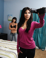 Dark haired mom Diana Prince slides her hand down her jeans to masturbate