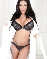 British female with black hair Emily B uncovers her huge breasts