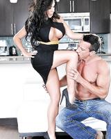 Gorgeous brunette Emily B is doing the best footjob to her muscular man