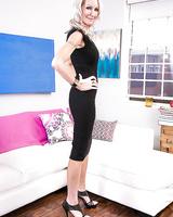 Older blonde MILF over 40 Emma Starr posing fully clothed in black dress