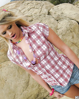 Beautiful blonde teen Heather Starlet exposing her shaved pussy outdoors