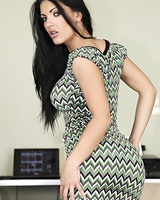 Brunette solo model Honey Damon peels off her tight dress and black panties