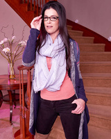 Mom with sexy glasses India Summer posing on the stairs in her high boots