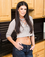 Brunette MILF India Summer goes from clothed to nude just like that in kitchen