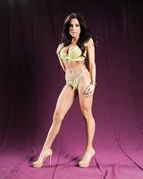 Brunette model Jaclyn Taylor unleashing large tits from lingerie in heels