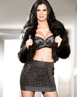 Dark haired MILF Jasmine Jae bares her big tits as she slips off her skirt