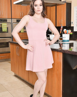 Hot wife with brown eyes strips naked on her kitchen counter