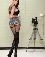 Kayla Carrera is too hot in her stockings and high boots to walk in the street