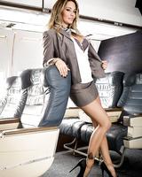 MILF pornstar Jessica Drake disrobing to masturbate on airplane in high heels