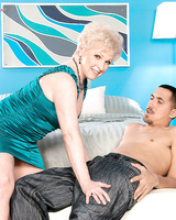 Horny granny Jewel seduces a young Latina man in a green dress