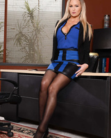 Blonde business woman Abbey Brooks strips to nylons and garters at work
