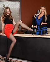 Business woman Abbey Brooks and her secretary Jillian Janson strip to hosiery