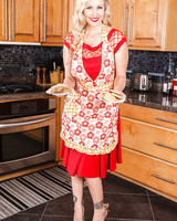 Older blonde MILF Julia Ann exposes her pussy after baking a batch of cookies