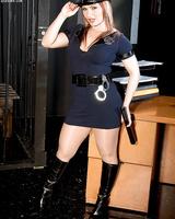 Chubby female policewoman Katja Kassin strips off her uniform after her shift