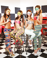 4 chick in in leggings and masks put down their guns for nude modeling gig