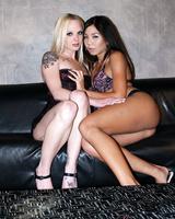 Asian female Keeani Lei & tattooed blonde Faye Runaway go lesbian on couch