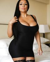 Chesty Latina MILF Kiara Mia letting huge knockers loose from dress