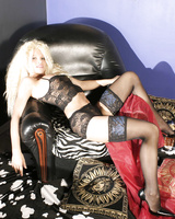 Kinky blonde Lola undresses
