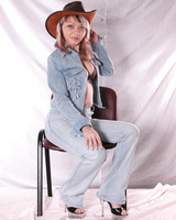 Girl in hat poses on the chair