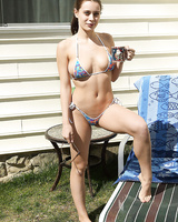 Solo girl Lana Rhoades sticks a medical device into her twat in the backyard