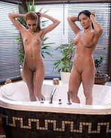 Naked hookers Lea Lexis & Crystal Crown are cleaned up before 3some sex