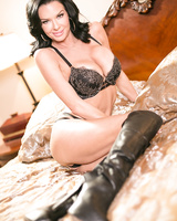 Brunette female Veronica Avluv removes her bra and panties on top of her bed