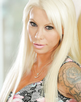 Gorgeous blonde tattoo model Lolly Ink poses non nude in black stockings