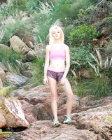 Nice blonde teen Maddy Rose pulls down her shorts and masturbates in the wild