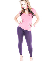 Busty MILF Madison Rose stripping out of spandex pants to pose naked