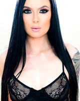 Dark haired model Marley Brinx sets her perky tits free of her black bra