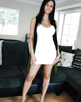 Busty mixed race chick Mary Jean striking sexy fully clothed poses in dress