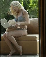 Blonde solo babe Melanie Gold slides hands down panties to masturbate