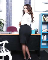 Nylon and skirt adorned secretary Mila Marx flashing leg and underwear