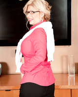 Mature blonde secretary Miss Deb loves giving a blowjob in the office
