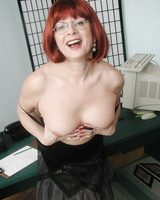 Mature redhead Miss Miss Abigail flashes her pink panties half naked