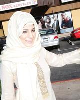 Libyan female Nadia Ali undresses before fucking a big black dick