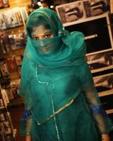 Indian female Nadia Ali sucks off a big black cock thru a glory hole