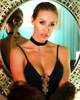 Sexy blond chick Nicole Aniston licks a mirror while admiring herself