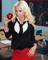 Blonde bombshell Nikita Von James strips naked after teaching a class