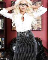 Blonde bombshell Nina Elle strips off her working clothes in her study