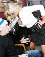 Blonde principal Nina Elle seduces a male student in a skirt and heels